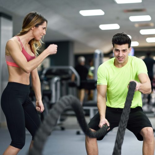 man-with-battle-ropes-exercise-in-the-fitness-gym