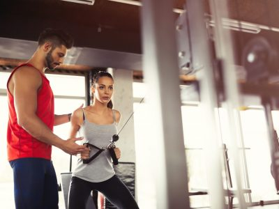 personal-trainer-helping-A6PXBEC